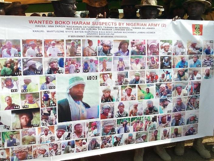 A poster shows pictures of the 100 most wanted Boko Haram Islamist suspects released by the Nigerian army in Damboa (AFP Photo/)