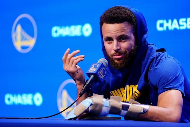 "<a class=""link rapid-noclick-resp"" href=""/nba/players/4612/"" data-ylk=""slk:Stephen Curry"">Stephen Curry</a>, wearing a prominent brace on his broken hand, vowed to return this season.(Daniel Shirey/Getty Images)"