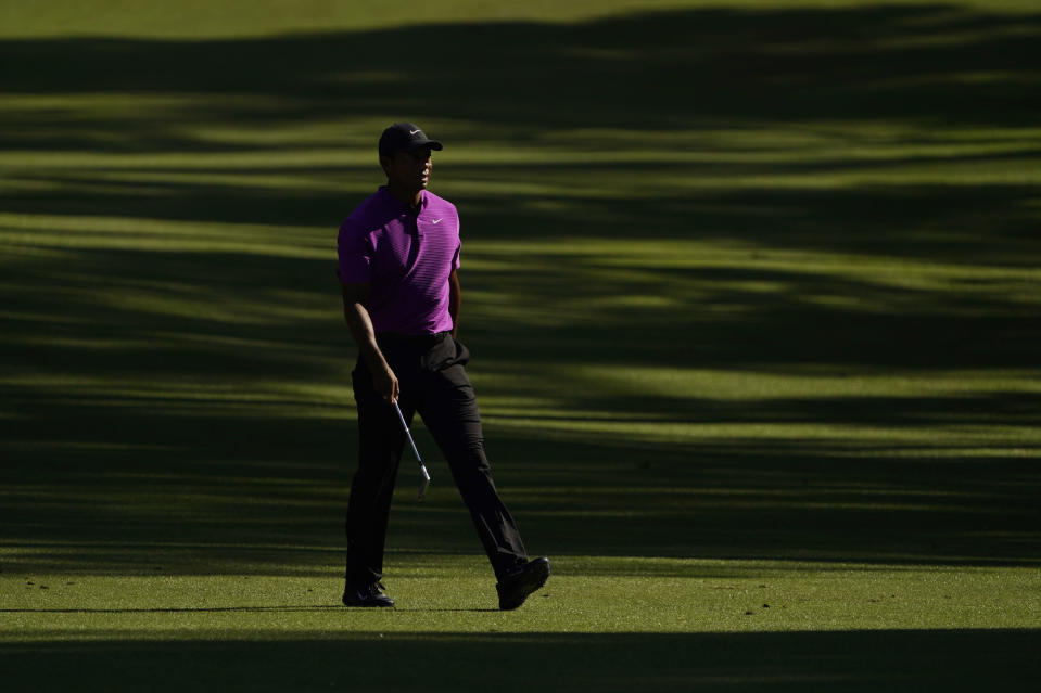 Tiger Woods walks on the 13th fairway during the third round of the Masters golf tournament Saturday, Nov. 14, 2020, in Augusta, Ga. (AP Photo/David J. Phillip)