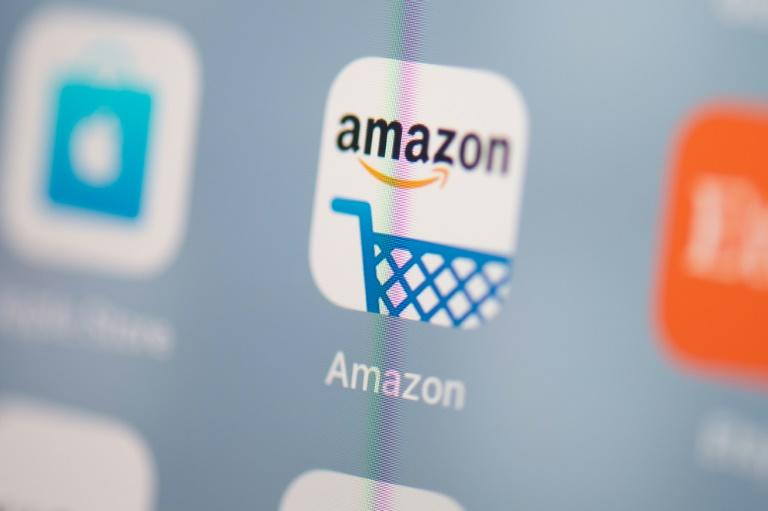 """Amazon's 48-hour prime """"day"""" helped boost US retail sales more than expected in July (AFP Photo/Martin BUREAU)"""