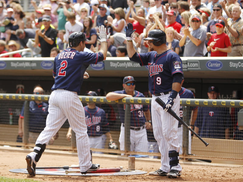 Minnesota Twins' Brian Dozier (2) is congratulated by Ryan Doumit (9) after hitting a two-run home run against Chicago White Sox starting pitcher John Danks during the second inning of a baseball game, Thursday, June 20, 2013, in Minneapolis. (AP Photo/Genevieve Ross)