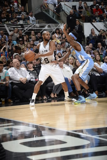 SAN ANTONIO, TX - APRIL 3: Patty Mills #8 of the San Antonio Spurs handles the ball against the Denver Nuggets on April 3, 2015 at the AT&T Center in San Antonio, Texas. (Photo by D. Clarke Evans/NBAE via Getty Images)