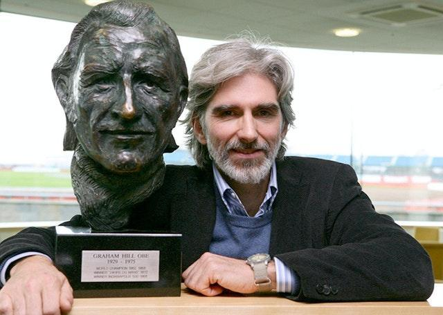 Damon Hill with a bust of his father, Graham, who like him also won the Formula One world title