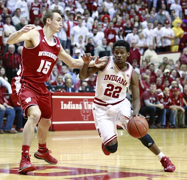 Indiana guard Stanford Robinson (22) drives with the basketball guarded by Wisconsin forward Sam Dekker (15) in the second half of an NCAA basketball game against Wisconsin in Bloomington, Ind., Tuesday, Jan. 14, 2014. Indiana won 75-72. (AP Photo/R Brent Smith)