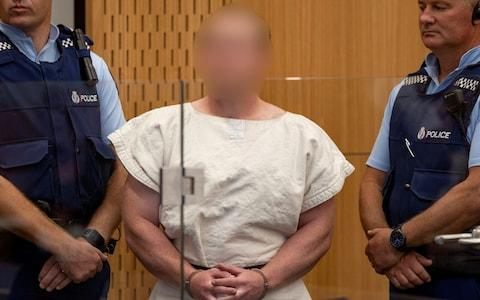 Brenton Tarrant, charged for murder in relation to the mosque attacks, is seen in the dock during his appearance in the Christchurch District Court last month - Credit: Reuters
