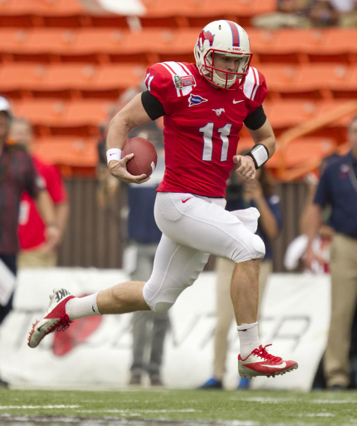 SMU quarterback Garrett Gilbert breaks free on a quarterback sneak against Fresno State in the first quarter of the Hawaii Bowl NCAA college football game Monday, Dec. 24, 2012, in Honolulu. (AP Photo/Eugene Tanner)