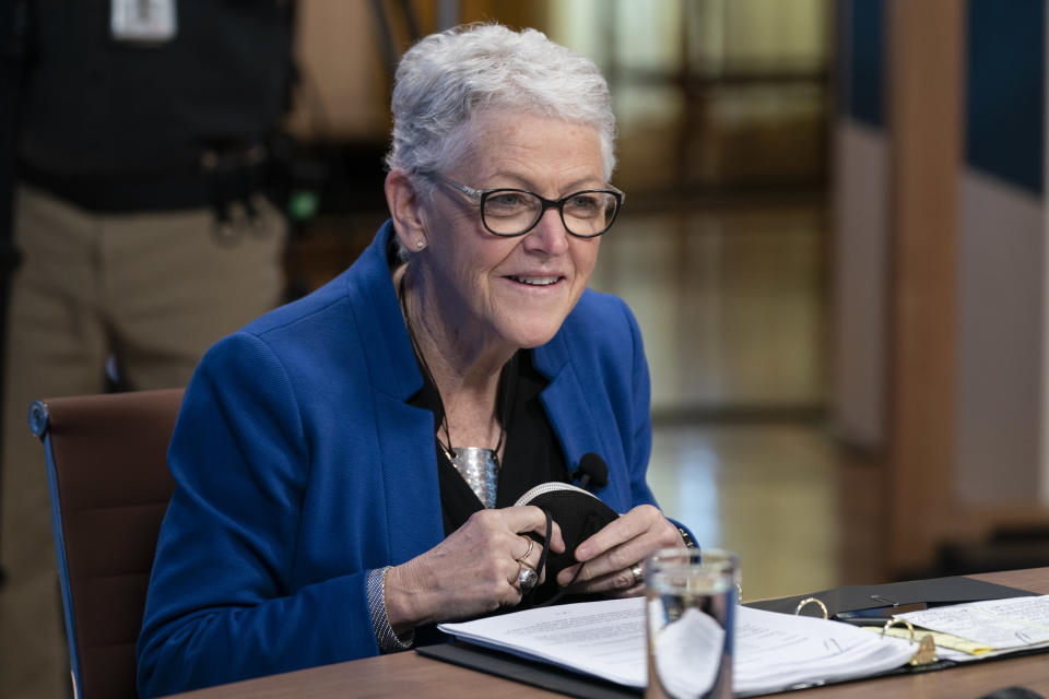 National Climate adviser Gina McCarthy waits for the arrival of President Joe Biden to speak to the virtual Leaders Summit on Climate, from the East Room of the White House, Friday, April 23, 2021, in Washington. (AP Photo/Evan Vucci)