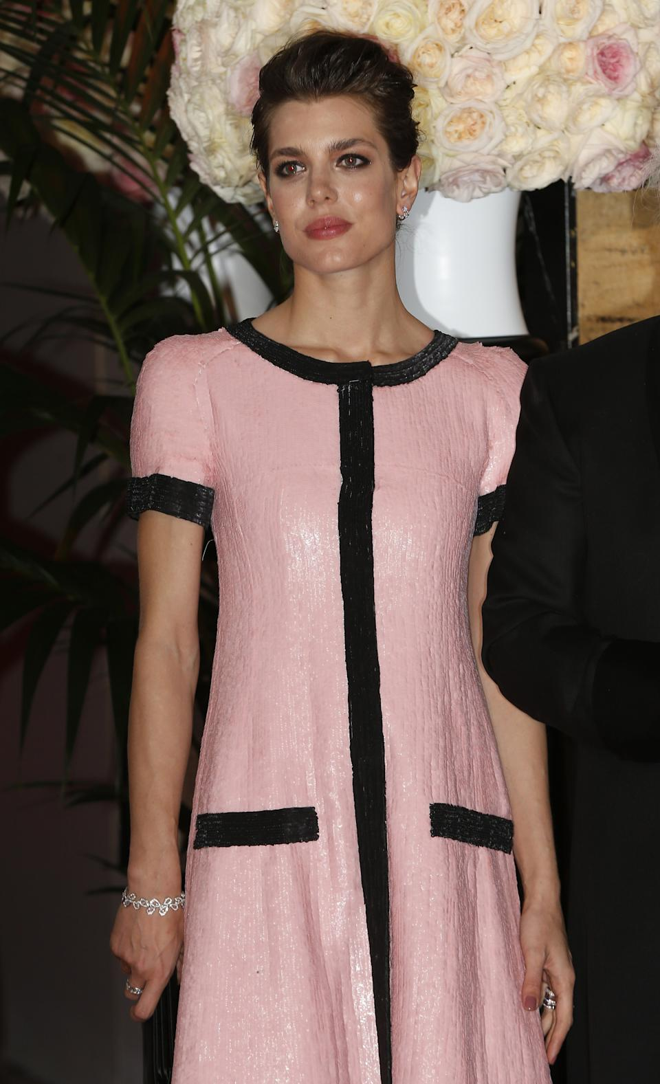 Charlotte Casiraghi arrives for the annual Rose Ball at the Monte-Carlo Sporting Club in Monaco, on March 28, 2015. The Rose Ball is one of the major charity events in Monaco. Created in 1954, it benefits the Princess Grace Foundation. AFP PHOTO / VALERY HACHE        (Photo credit should read VALERY HACHE/AFP via Getty Images)
