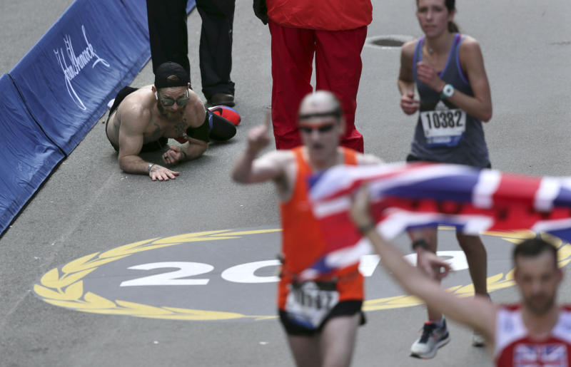 Micah Herndon, who crawled over the Boston Marathon finish line last year while honoring his fallen comrades, will compete in the race again in April. (AP/Charles Krupa)