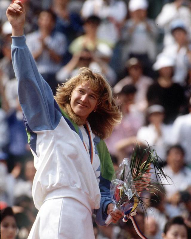 """<span class=""""element-image__caption"""">Graf with her Olympic gold medal in 1988.</span> <span class=""""element-image__credit"""">Photograph: BTS</span>"""
