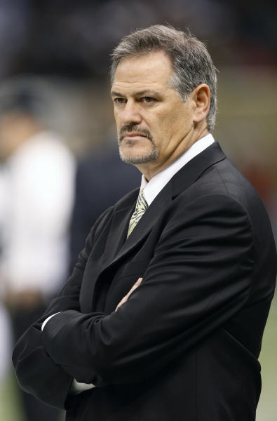 FILE - In this Dec. 19, 2099, file photo, New Orleans Saints general manager Mickey Loomis watches from the sidelines before the start of the Saints-Dallas Cowboys NFL football game in New Orleans. The NFL has suspended New Orleans head coach Sean Payton for the 2012 season, and former Saints defensive coordinator Gregg Williams is banned from the league indefinitely because of the team's bounty program that targeted opposing players. Also Wednesday, March 21, 2012, Goodell suspended Saints general manager Mickey Loomis for the first eight regular-season games of 2012, and assistant coach Joe Vitt has to sit out the first six games. (AP Photo/Bill Haber, File)