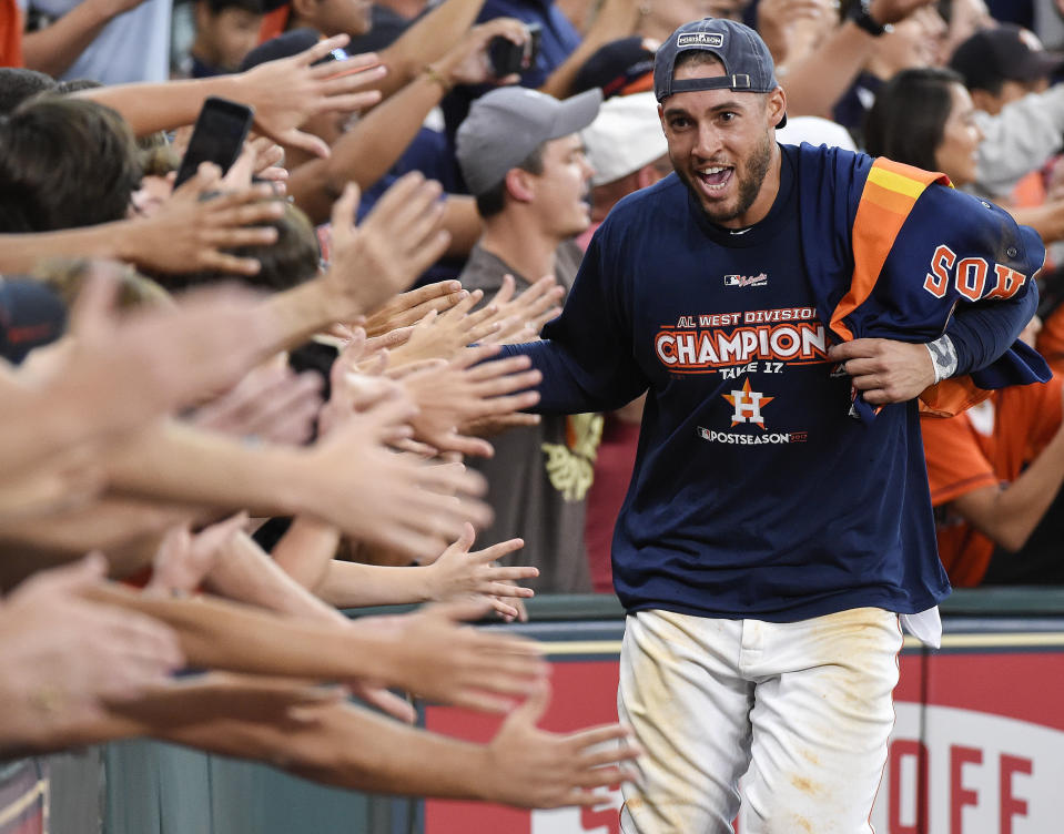 FILE - Houston Astros' George Springer celebrates with fans after the team's win over the Seattle Mariners and clinching of the AL West crown in a baseball game in Houston, in this Sunday, Sept. 17, 2017, file photo. It's a sad time for Houston sports fans after multiple superstars have left he city in the last year. (AP Photo/Eric Christian Smith, File)
