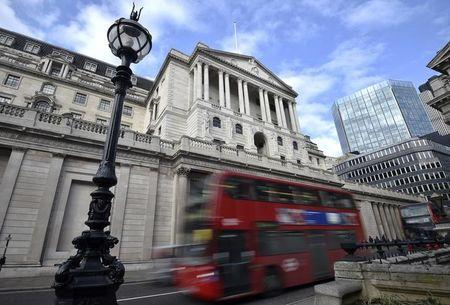 A bus passes the Bank of England in the City of London