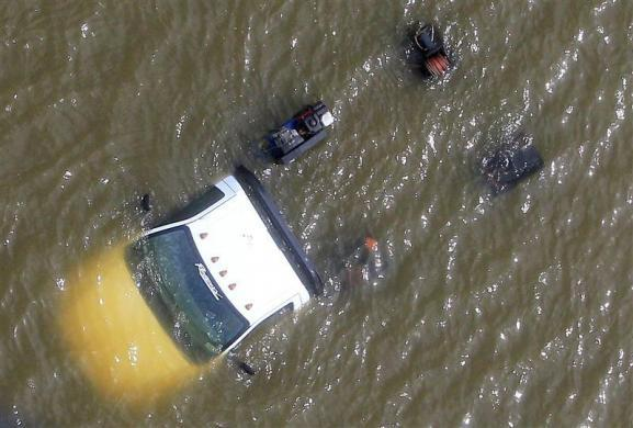 A truck is submerged in flood waters after a Hurricane Isaac levee breach in Braithwaite, Louisiana August 31, 2012.