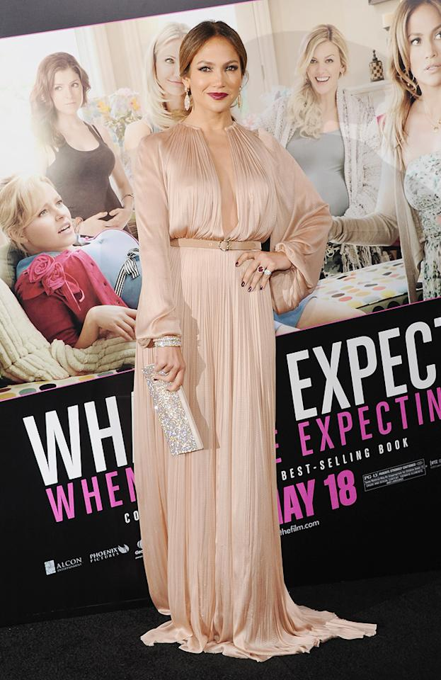 "<b>Don't trip J.Lo!</b><br><br>Dripping in jewels and a plunging Lucia Hohan gown, Jennifer Lopez evokes old Hollywood glamour at the Los Angeles premiere of her film ""<a href=""http://movies.yahoo.com/movie/what-to-expect-when-youre-expecting/"">What to Expect When You're Expecting</a>"" on Monday night. <br><br>Is there such a thing as <em>below</em> floor length? Aside from the dramatic neckline, J.Lo's full-length, nude-toned, fabric-full Grecian dress completely drapes her, falling well below her feet.<br><br>The 42-year-old fared well as she brought her 25-year-old boyfriend, dancer Casper Smart, who would have probably picked her up if she fell.<br><br>""What to Expect"" opens in theaters this Friday."