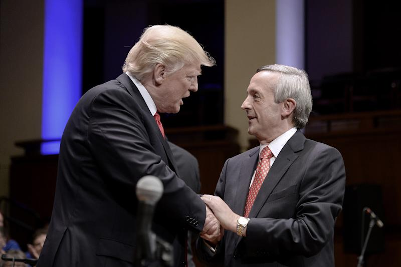 """Robert Jeffress (right) says God is the one who """"established nations and its borders."""" (Olivier Douliery/Bloomberg via Getty Images)"""