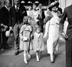 <p>The two young princesses walk with their mother (PA Archive) </p>