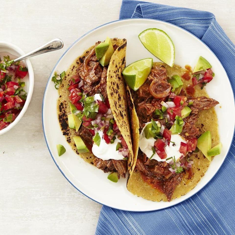 """<p>You're going to want to save this one for your next Taco Tuesday. The beef chuck becomes tender as it is slowly cooked in tomato sauce, adobo, and chipotle. And when it's ready to eat, you can make the pico de gallo in minutes.</p><p><em><a href=""""https://www.womansday.com/food-recipes/food-drinks/recipes/a12886/chipotle-beef-tacos-pico-de-gallo-recipe-wdy1014/"""" rel=""""nofollow noopener"""" target=""""_blank"""" data-ylk=""""slk:Get the recipe from Woman's Day »"""" class=""""link rapid-noclick-resp"""">Get the recipe from Woman's Day »</a></em></p>"""