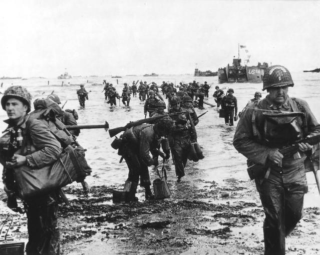 <p>U.S. reinforcements land on Omaha Beach during the Normandy D-Day landings near Vierville-sur-Mer, France, on June 6, 1944. (Photo: Cpt. Herman Wall/U.S. National Archives/handout via Reuters) </p>