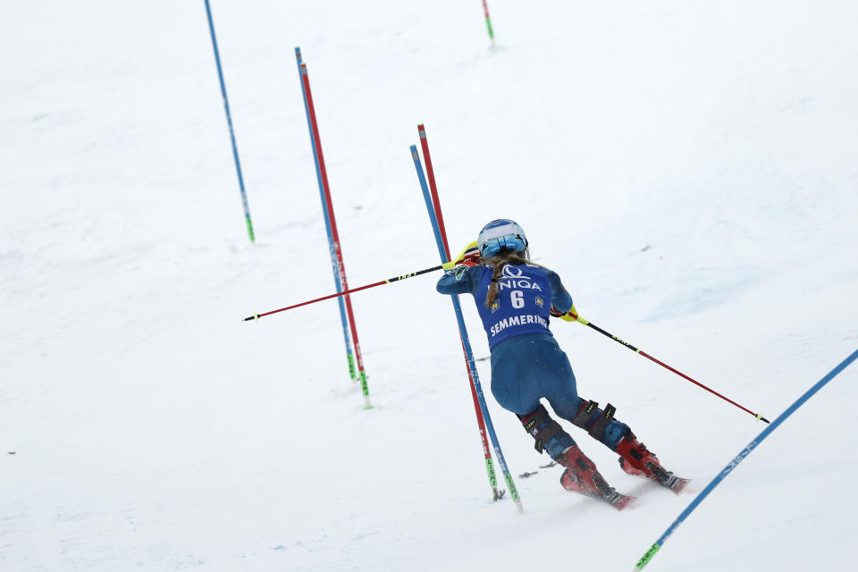 United States' Mikaela Shiffrin speeds down the course during an alpine ski, women's World Cup slalom, in Semmering, Austria, Tuesday, Dec. 29, 2020. (AP Photo/Gabriele Facciotti)