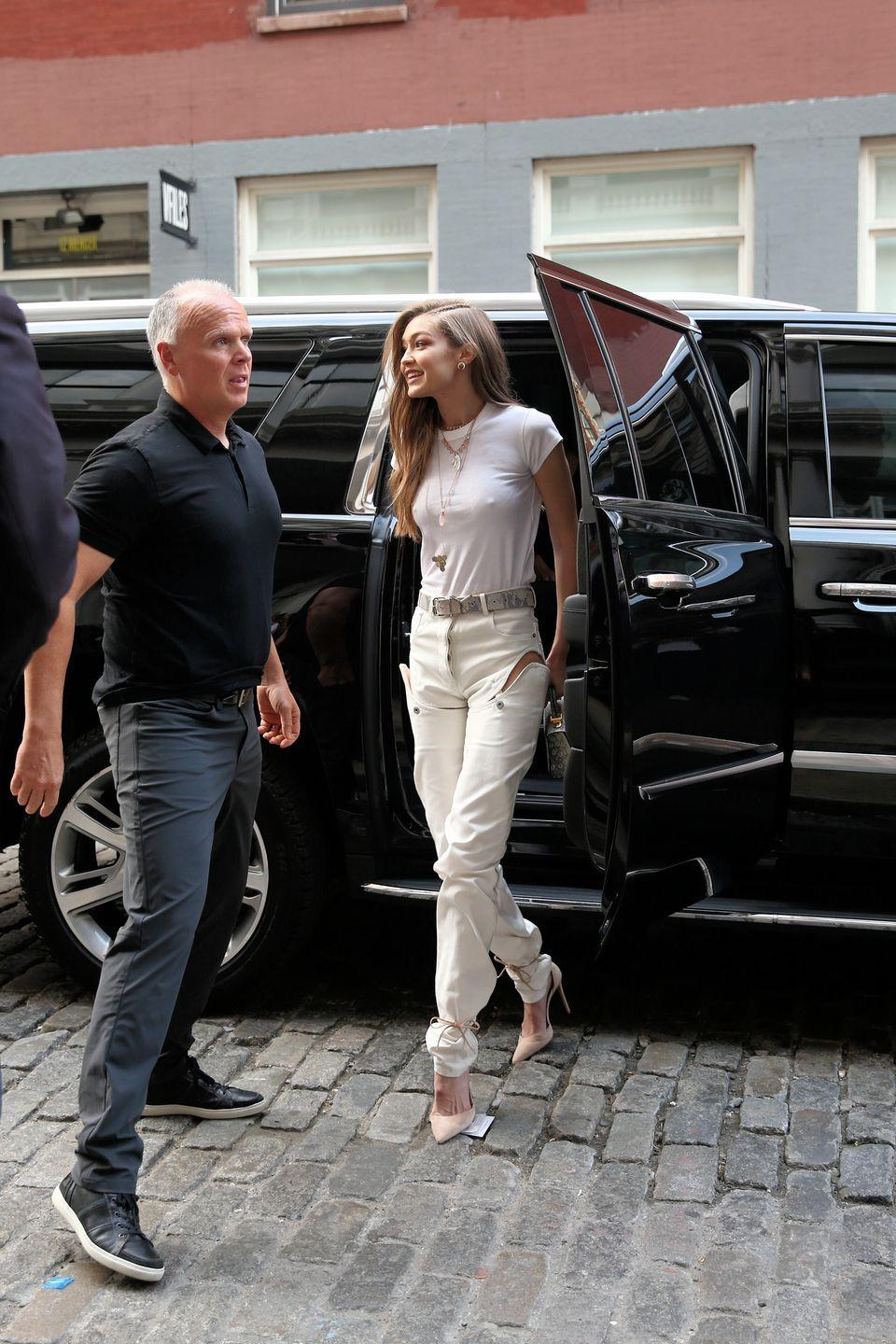 <p>In a white top and white, detachable pants while out in New York City.</p>