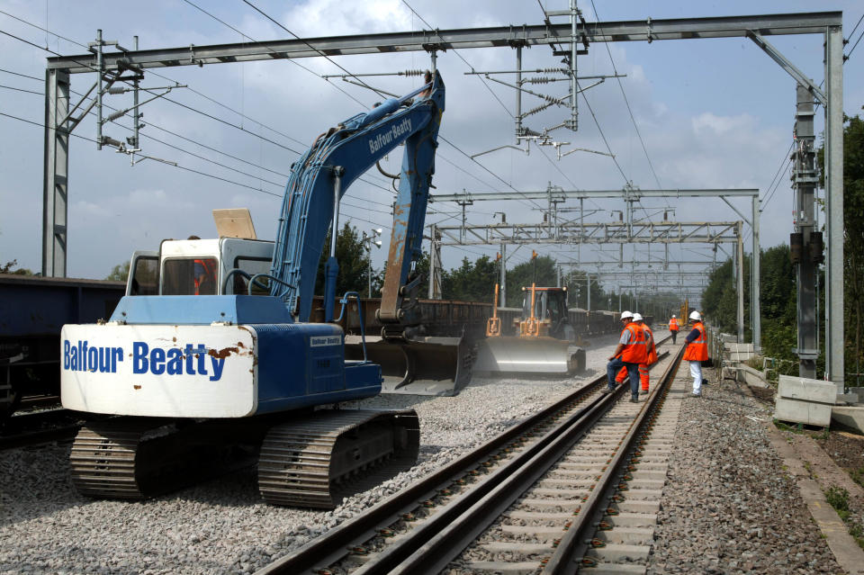 Reballasting the track formation at Bourne End in August 2003 during the West Coast Main Line upgrade, United Kingdom. (Photo by Rail Photo/Construction Photography/Avalon/Getty Images)