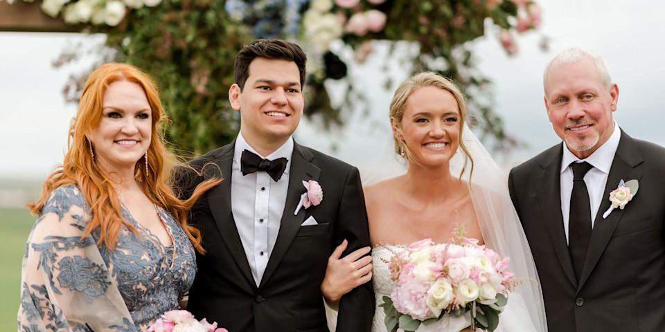 A mother and father stand proudly next to a smiling bride and groom (Courtesy of Ashley Alexander Photography)