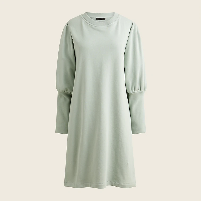 """<h2>J.Crew Original Cotton Terry Puff-Sleeve Sweatshirt </h2><br>Anyone who has ever worked in an office knows that it is almost always freezing. This sweatshirt dress is an excellent workwear piece, but it's also super cozy — perfect for surviving the AC blast.<br><br><em>Shop<strong><a href=""""https://www.jcrew.com/p/womens/categories/clothing/dresses-and-jumpsuits/original-cotton-terry-puff-sleeve-sweatshirt-dress/BA957?display=standard&fit=Classic&color_name=light-mint&colorProductCode=BA957"""" rel=""""nofollow noopener"""" target=""""_blank"""" data-ylk=""""slk:J.Crew"""" class=""""link rapid-noclick-resp""""> J.Crew</a></strong></em><br><br><strong>J.Crew</strong> Original cotton terry puff-sleeve sweatshirt dress, $, available at <a href=""""https://go.skimresources.com/?id=30283X879131&url=https%3A%2F%2Fwww.jcrew.com%2Fp%2Fwomens%2Fcategories%2Fclothing%2Fdresses-and-jumpsuits%2Foriginal-cotton-terry-puff-sleeve-sweatshirt-dress%2FBA957%3Fdisplay%3Dstandard%26fit%3DClassic%26color_name%3Dlight-mint%26colorProductCode%3DBA957"""" rel=""""nofollow noopener"""" target=""""_blank"""" data-ylk=""""slk:J.Crew"""" class=""""link rapid-noclick-resp"""">J.Crew</a>"""