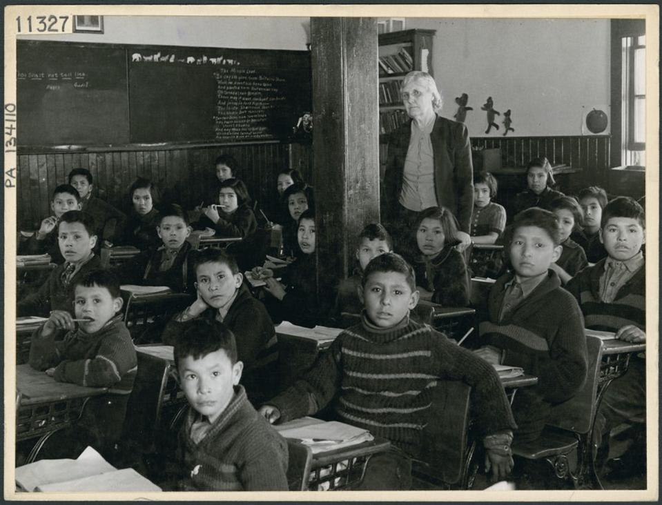 Students sit in classroom at Indian Residential School
