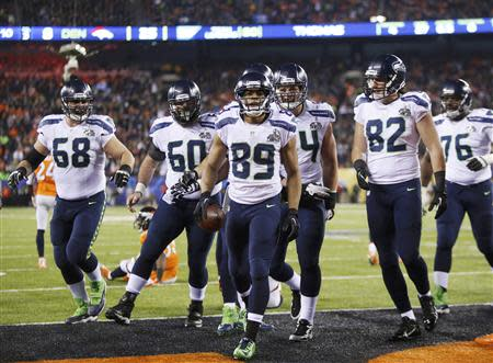 Seattle Seahawks wide receiver Doug Baldwin (89) celebrates his touchdown against the Denver Broncos with teammates during the fourth quarter in the NFL Super Bowl XLVIII football game in East Rutherford, New Jersey, February 2, 2014. REUTERS/Carlo Allegri