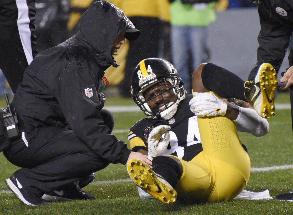 Steelers receiver Antonio Brown went down with an injury that will likely end his fantasy season. (AP Photo).