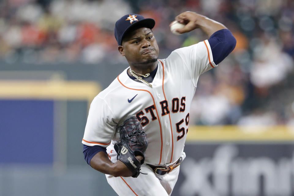 Houston Astros starting pitcher Framber Valdez throws to a Minnesota Twins batter during the first inning of a baseball game Thursday, Aug. 5, 2021, in Houston. (AP Photo/Michael Wyke)
