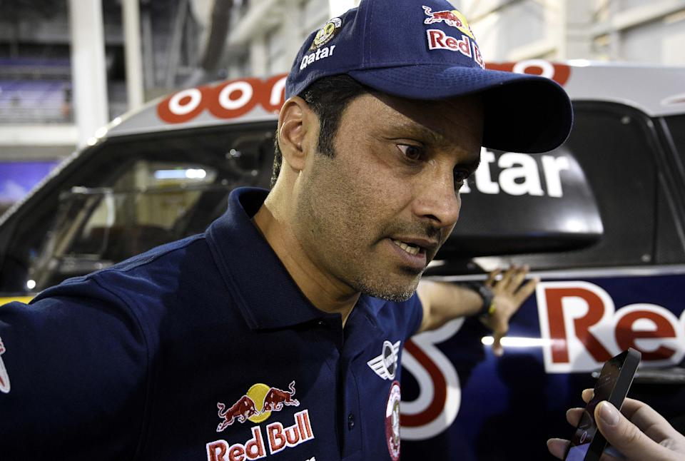 Mini's driver Nasser Al-Attiyah of Qatar speaks to journalists in Buenos Aires on January 3, 2015 before the start of the 2015 Dakar Rally (AFP Photo/Franck Fife)