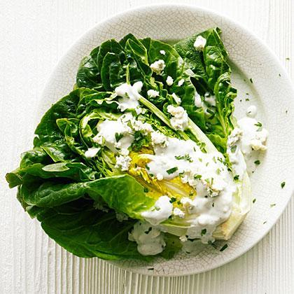 """<p>We've updated the classic wedge <a href=""""https://www.myrecipes.com/salad-recipes"""" rel=""""nofollow noopener"""" target=""""_blank"""" data-ylk=""""slk:salad"""" class=""""link rapid-noclick-resp"""">salad</a>, using homemade blue cheese dressing and flavorful Little Gem lettuce in place of the traditional iceberg.</p>"""