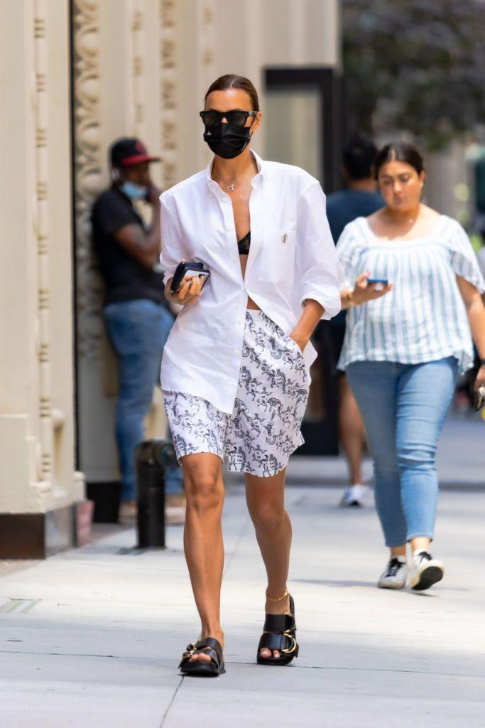 """<p>Days after being spotted in <a href=""""https://www.elle.com/uk/life-and-culture/a36683957/kanye-west-irina-shayk-relationship/"""" rel=""""nofollow noopener"""" target=""""_blank"""" data-ylk=""""slk:France with rumoured beau Kanye West"""" class=""""link rapid-noclick-resp"""">France with rumoured beau Kanye West</a>, Irina Shayk stepped out in New York to do the school run with daughter Lea De Seine. The model was ready for the summer heat in an oversized shirt that she left almost completely unbuttoned, she paired the men's Burberry shirt with logo-covered boxer-style shorts from the same brand, alongside black sunnies and chunky sandals.</p><p><a class=""""link rapid-noclick-resp"""" href=""""https://go.redirectingat.com?id=127X1599956&url=https%3A%2F%2Fuk.burberry.com%2Fmonogram-motif-applique-cotton-oxford-shirt-p80416951&sref=https%3A%2F%2Fwww.elle.com%2Fuk%2Ffashion%2Fcelebrity-style%2Fg34359706%2Firina-shayk-style-file%2F"""" rel=""""nofollow noopener"""" target=""""_blank"""" data-ylk=""""slk:SHOP IRINA'S SHIRT NOW"""">SHOP IRINA'S SHIRT NOW</a></p>"""