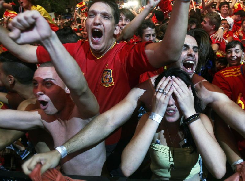 Spanish fans celebrates Spain's victory over Portugal in their Euro 2012 soccer championship semifinal match, during a viewing at the Fan Zone in Madrid Wednesday, June 27, 2012. (AP Photo/Andres Kudacki)