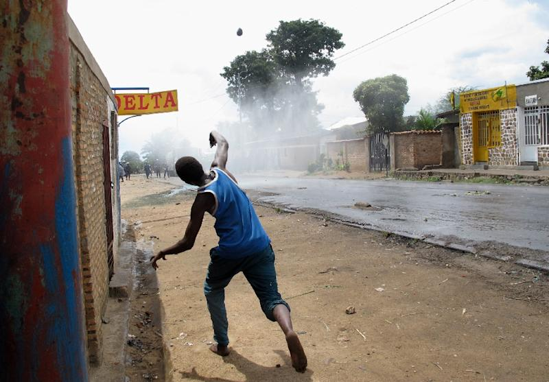 A protester throws stones at police during street battles in Bujumbura on May 4, 2015
