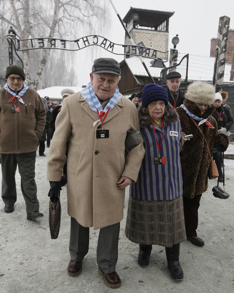 Holocaust survivors arrive for a ceremony to mark the 69th anniversary of the liberation of Auschwitz Nazi death camp's in Oswiecim, Poland, on Monday, Jan. 27, 2014, since the Soviet Red Army liberated the camp. Israeli lawmakers and government officials are to attend anniversary observances later in the day. The Nazis killed some 1.5 million people, mostly Jews at the camp during World War II. (AP Photo/Czarek Sokolowski)
