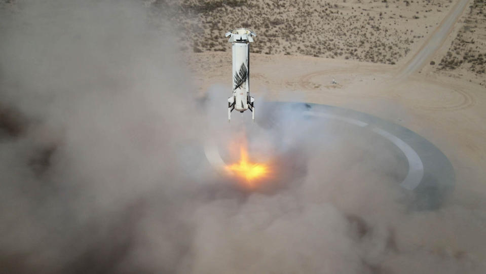 In this Jan. 14, 2021 photo made available by Blue Origin, the New Shepard NS-14 booster rocket lands at Launch Site One in West Texas. (Blue Origin via AP)