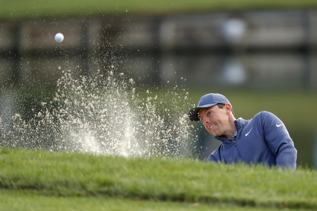 Rory McIlroy hits out of the bunker on the 12th hole during the first round of the Valspar Championship golf tournament Thursday, March 8, 2018, in Palm Harbor, Fla. (AP Photo/Mike Carlson)
