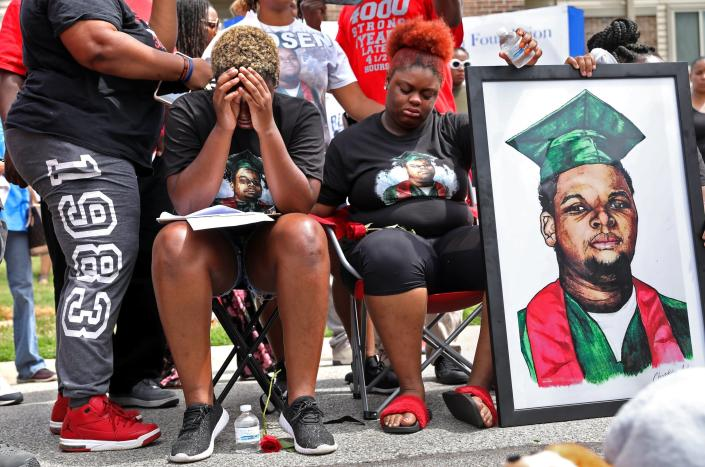 """FILE - Trinetta Brown, center left, 19, and Triniya Brown become emotional during a memorial service for their brother, Michael Brown, Thursday, Aug. 9, 2018, in the Canfield Green apartment complex in Ferguson, Mo. St. Louis County's top prosecutor announced Thursday, July 30, 2020, that he will not charge the former police officer who fatally shot Brown. But, he said, """"our investigation does not exonerate Darren Wilson."""" (Cristina M. Fletes/St. Louis Post-Dispatch via AP, File)"""