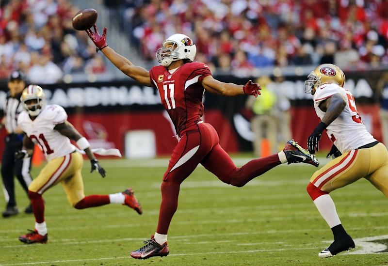 Arizona Cardinals wide receiver Larry Fitzgerald (11) can't hold on to the ball as San Francisco 49ers inside linebacker Patrick Willis defends during the second half of an NFL football game, Sunday, Dec. 29, 2013, in Glendale, Ariz. (AP Photo/Matt York)