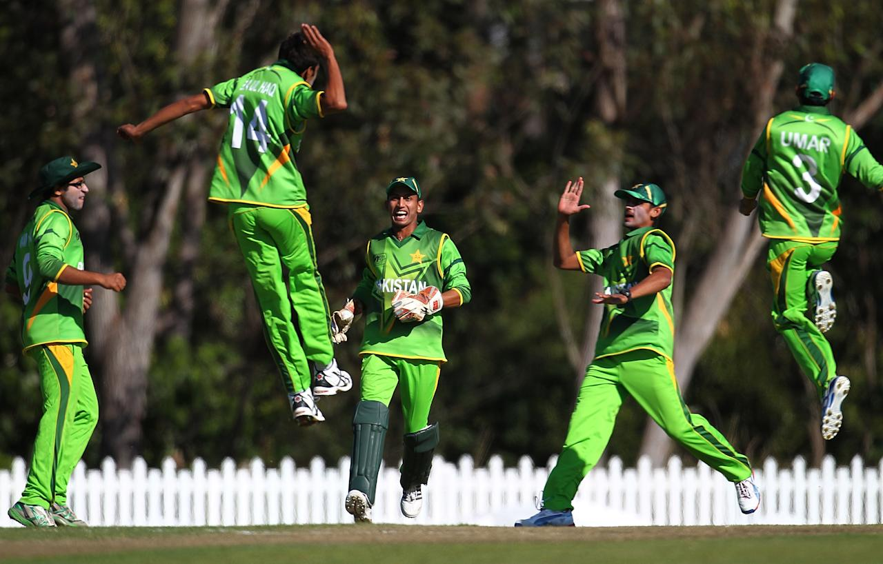 SUNSHINE COAST, AUSTRALIA - AUGUST 11:  Pakistan players celebrate during the ICC U19 Cricket World Cup 2012 match between Pakistan and Afghanistan at John Blanck Oval on August 11, 2012 in Sunshine Coast, Australia.  (Photo by Graham Denholm-ICC/Getty Images)
