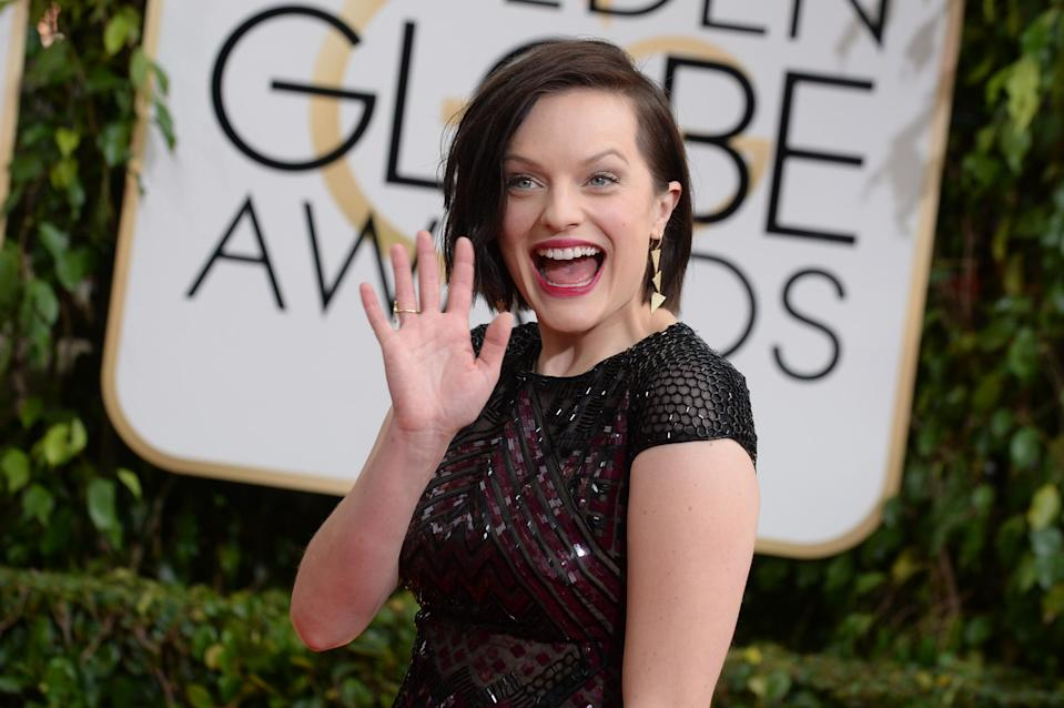 Elisabeth Moss arrives at the 71st annual Golden Globe Awards at the Beverly Hilton Hotel on Sunday, Jan. 12, 2014, in Beverly Hills, Calif. (Photo by Jordan Strauss/Invision/AP)