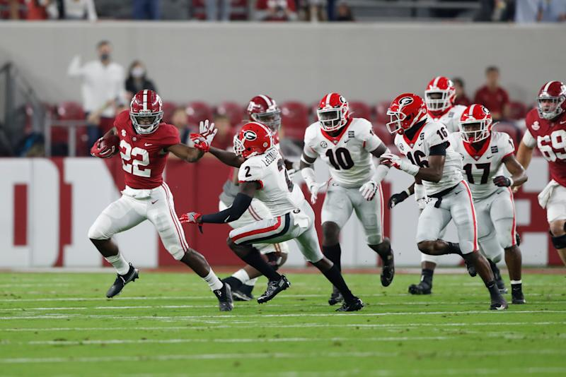 Najee Harris blocks during a run in the first half against Georgia.