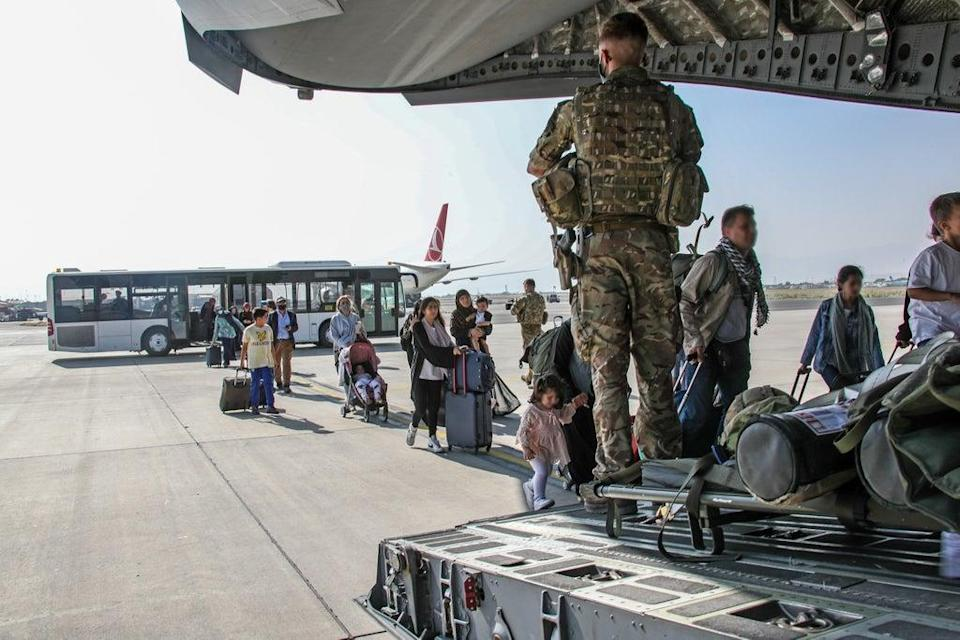British citizens and dual nationals get on an RAF plane out of Afghanistan (Ministry of Defence/PA) (PA Media)
