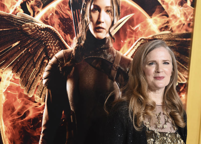 """FILE - In a Monday, Nov. 17, 2014 file photo, Suzanne Collins arrives at the Los Angeles premiere of """"The Hunger Games: Mockingjay - Part 1"""" at the Nokia Theatre L.A. Live. A decade after seemingly wrapping up """"The Hunger Games,"""" Suzanne Collins is bringing readers back to Panem. A prequel, set 64 years before the beginning of her multimillion-selling trilogy, is scheduled for release on May 19, 2020. (Photo by Jordan Strauss/Invision/AP, File)"""