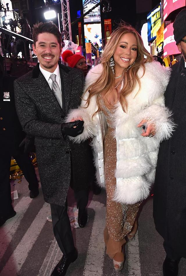 <p>The singer had her man by her side as she suited up in a glittery gown and white fur for her comeback performance on<em> Dick Clark's New Year's Rockin' Eve </em>with Ryan Seacrest on Sunday night in Times Square. Despite a tiny missing-tea mishap, the butterfly queen redeemed herself after last year's disaster of a set. (Photo: Kevin Mazur/Getty Images for dick clark productions) </p>