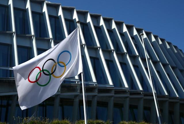 The Olympic flag flutters outside the International Olympic Committee (IOC) in Lausanne
