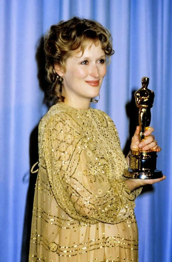 """<p>""""Oh boy. No matter how you try to imagine what this is like, it is so incredibly thrilling right down to your toes,"""" said Streep upon picking up the Oscar for Best Actress for <i>Sophie's Choice</i> in a full-length beaded gold frock with three-quarter sleeves.</p>"""